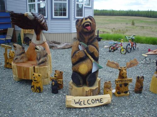Bear with a Fish Chainsaw Carving