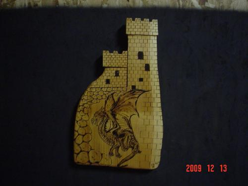 Dragon and Castle Chainsaw Carving