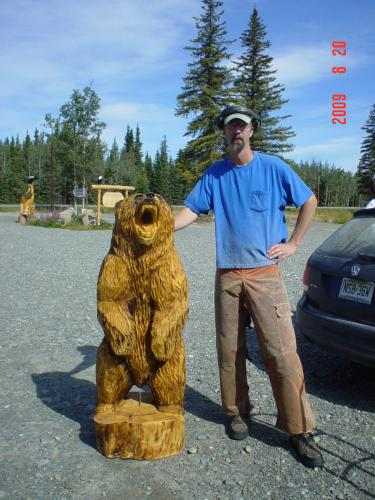 chainsaw carved Alaskan spruce growling grizzly bear
