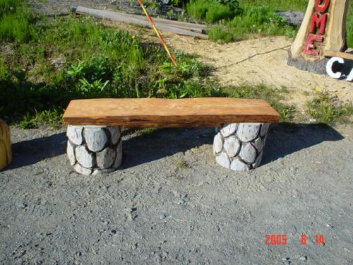 Eric Carved The Rock Bench Out Of Western Red Cedar. He Used A Gray Stain  On The Rocks And A Redwood Stain For The Plank Of The Bench.
