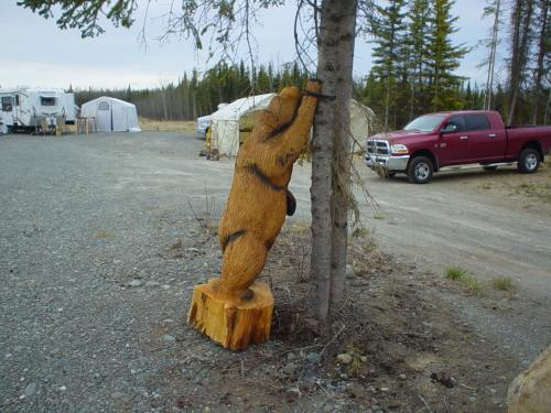 Bear Leaning Chainsaw Carving
