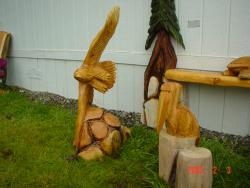 Pelican and eagle chainsaw carvings