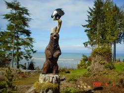 Eagle bear fish chainsaw carving art sculpture