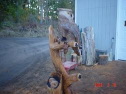 Great Horned Owl and Owlets chainsaw carving