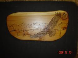 Soaring eagle and mountains chainsaw carving pyrography