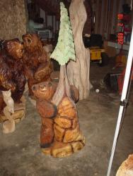 Tree Huggin chainsaw carving wood sculpture