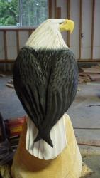 Perched eagle chainsaw carving art sculpture