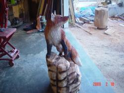 Fox on Rocks chainsaw sculpture