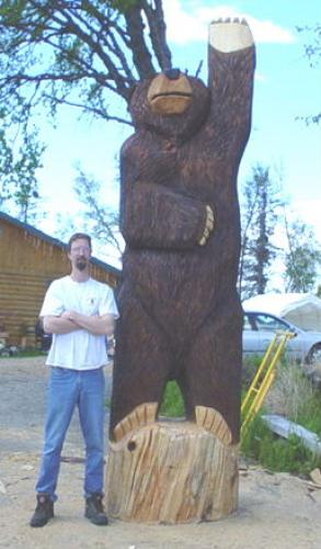 Massive Waving Bear Chainsaw Carving for Great Bear Ford in Soldotna Alaska
